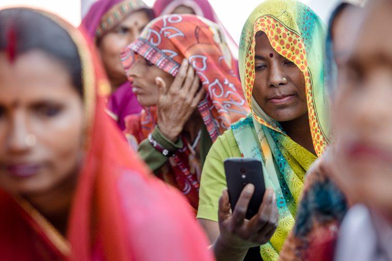 Woman uses mobile phone