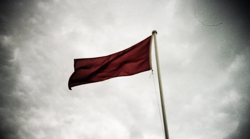 Red flag against clouds