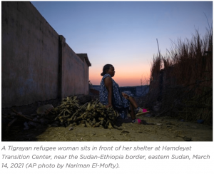 a Tigrayan refugee sits in front of her shelter at Hamdeyat Transition Center, Ethiopia