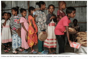 children in line for food tigray
