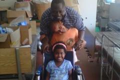Dr. Patrick Opio, with Dyan's children, Ayele and Hadia, in Uganda, 2011 (courtesy of Dyan Mazurana)